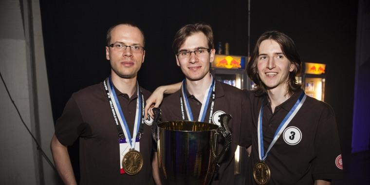 Image: Wojciech Jaskowski, Tomasz Zurkowski and Piotr Zurkowski from the Polish Team Need for C, pose with the trophy after winning the coding world finals