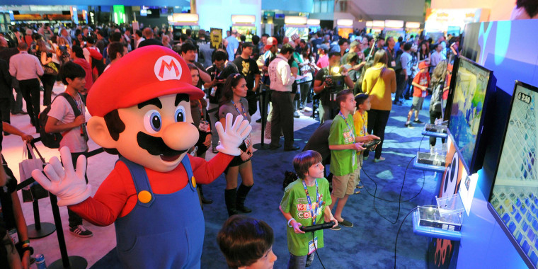 LOS ANGELES, CA - JUNE 11: In this photo provided by Nintendo of America, Evan, 8,(bottom), Caleb, 11, Jonah, 12, and Noah, 13, visit Nintendo's booth during E3 on June 11, 2014 in Los Angeles, California. The children become the first kids in the world to score exclusive hands-on time with Splatoon, a new video game for the Wii U console that Nintendo announced at the trade show in Los Angeles.