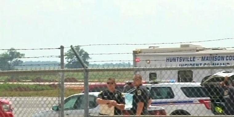 Image: First responders on the scene of a plane crash in Hunstville, Ala.