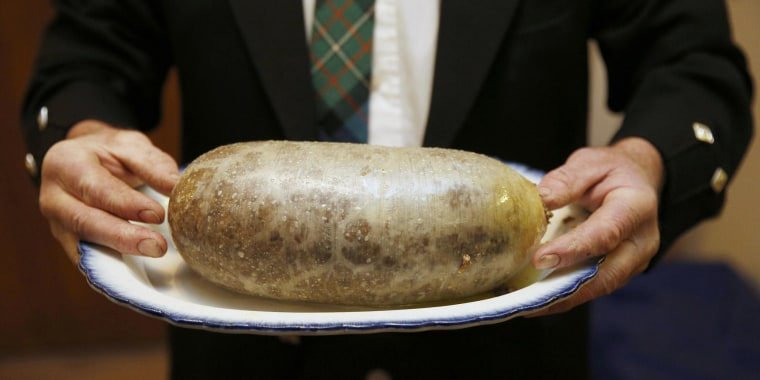 Image: A Haggis is carried at a Burns supper in Killiecrankie