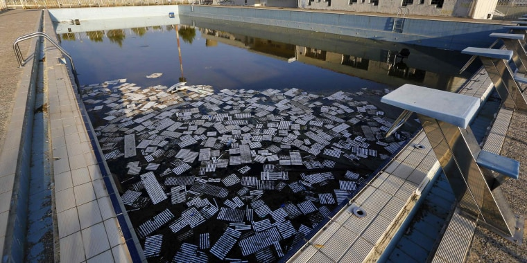 Image Garbage Floats In A Deserted Swimming Pool At The Olympic Village Thrakomakedones