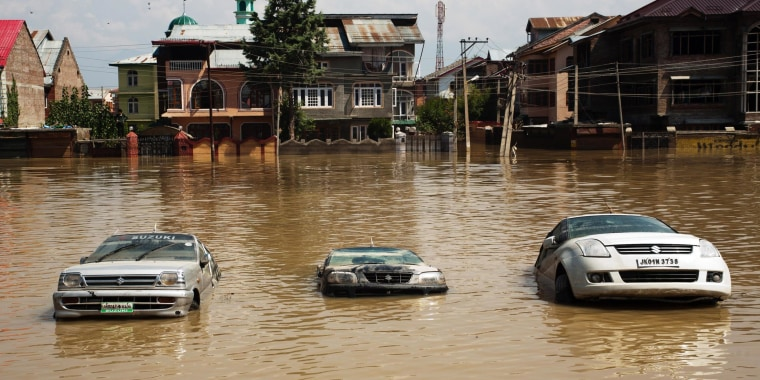 Image: Cars sit submerged on a road in the flooded Bemina area in Srinagar