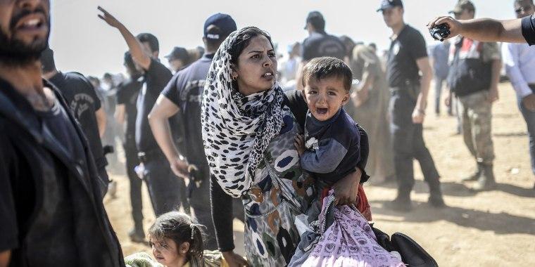Image: Syrian Kurds Cross Border Into Turkey