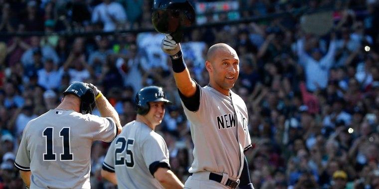 Image: New York Yankees designated hitter Derek Jeter tips his cap to the crowd