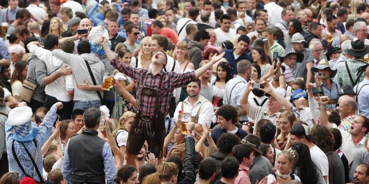 Image: Visitors enjoy beer during visit to Oktoberfest in Munich