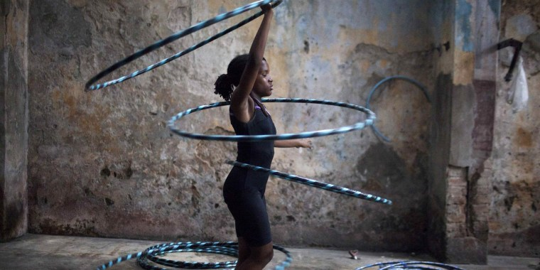 Image: Girl performs with hoops during a training session at a circus school in Havana