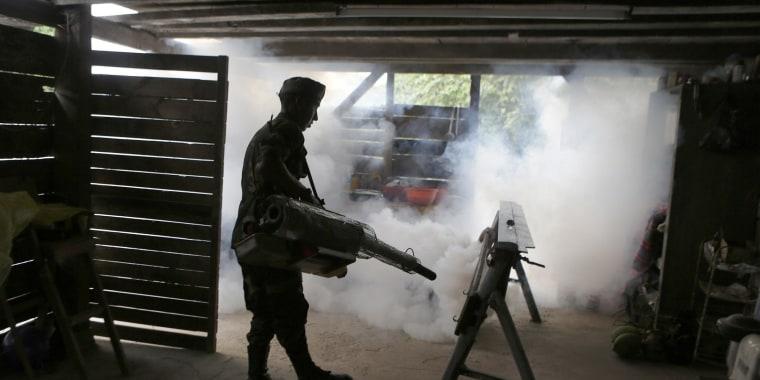 Image: A Bolivian soldier fumigates a slum