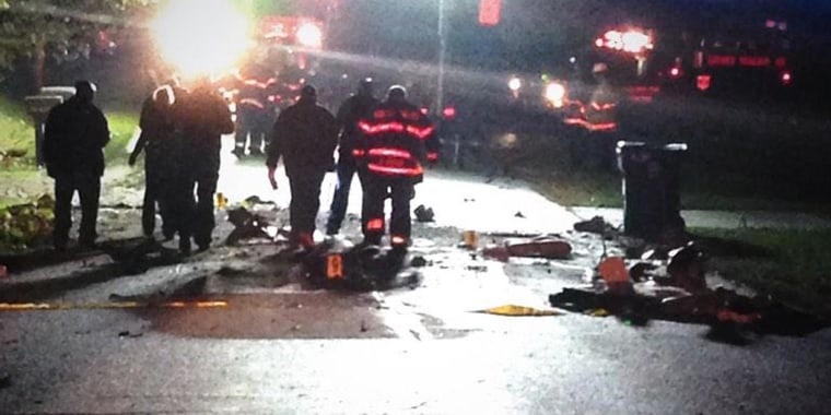 Emergency responders near the scene where a small plane crashed in a Chicago suburb.