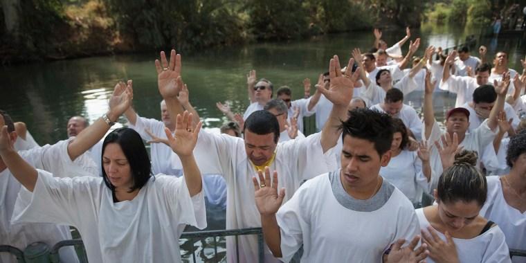 Image: Christian pilgrims from Brazil are baptized near the northern Israeli city of Tiberias
