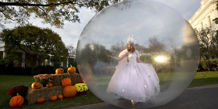 A actress dressed as Glinda, the Good Witch of the North from the Movie 'The Wizard of Oz,' performs by the Rose Garden of the White House before President Barack Obama greeted costumed children during Halloween festivities at the White House in Washington, on Oct. 31. President Barack Obama and first lady Michelle Obama welcomed local children and children of military families to 'trick-or-treat' at the White House for Halloween.