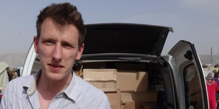 Image: Peter Kassig with a truck filled with supplies for Syrian refugees.