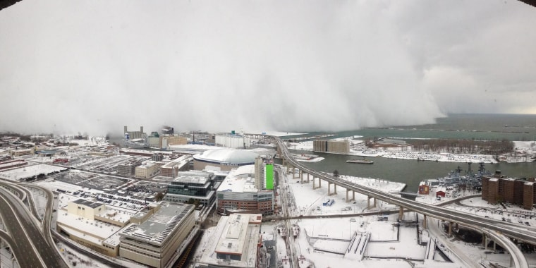 Image: Clouds of snow creep towards One Seneca Tower in downtown Buffalo, N.Y., on Nov. 18, looking out over Lake Erie.