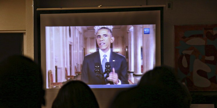 Image: Guests watch President Barack Obama's White House speech on immigration in San Diego