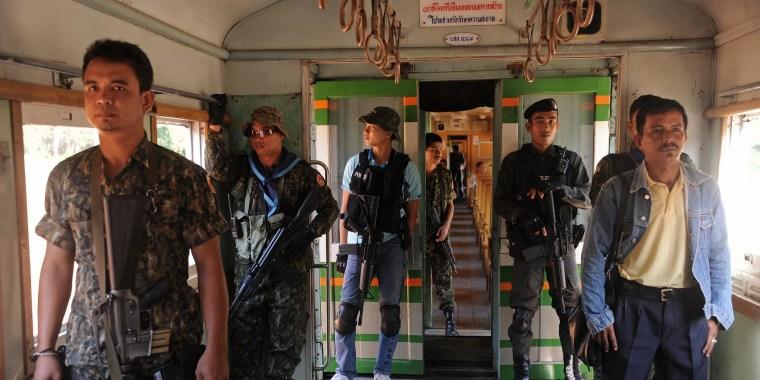 Thai guards on a train
