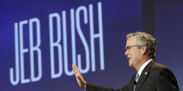 Former Florida Gov. Jeb Bush waves while being introduced before speaking at the National Automobile Dealers Association convention in San Francisco, Friday, Jan. 23, 2015. (AP Photo/Jeff Chiu)