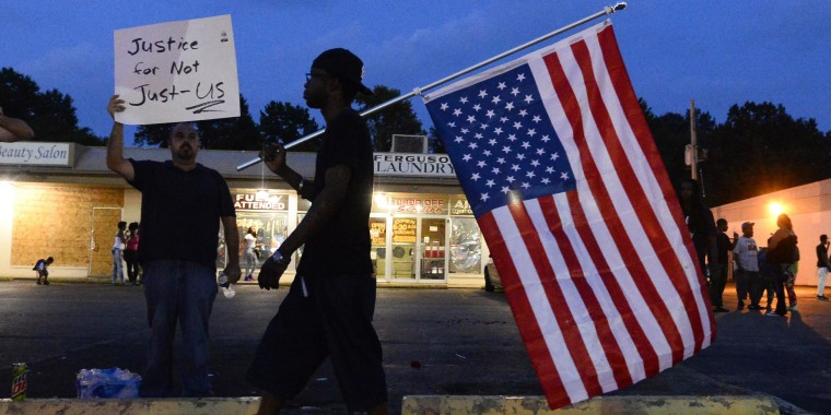 Image: emonstrators march in protest over the shooting death of Michael Brown in Ferguson