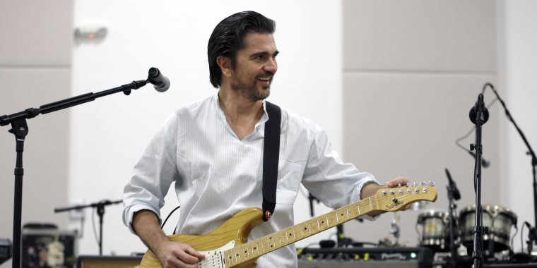 In this Feb. 2, 2015 photo, performer Juanes, of Colombia, tweaks his guitar in his practice studio in Doral, Fla. Juanes will be singing again at the Grammy Awards on Sunday, Feb. 8, 2015, but this time it will be a song of his own, in Spanish. (AP Photo/Alan Diaz)