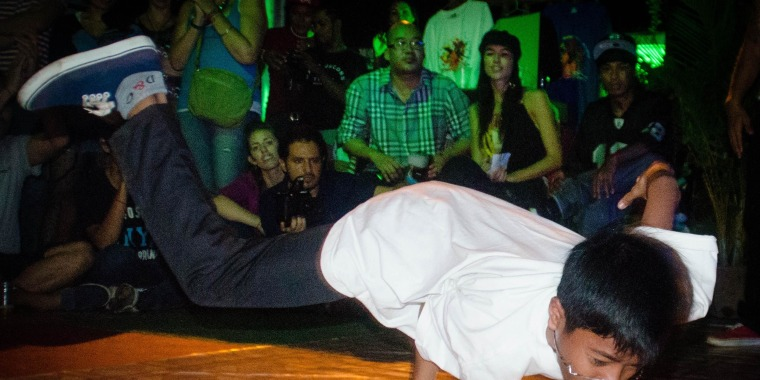 One of the children KK taught to breakdance at Tiny Toones shows off his moves.