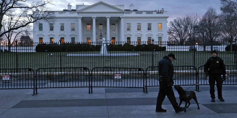 Image: Secret Service Uniformed Division officers patrol in front of the White House in Washington