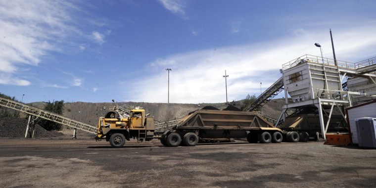 A three trailer truck takes on a load of phosphate ore at a hopper near Monsanto Company's South Rasmussen Mine Operation on Thursday, July 16, 2009 near Soda Springs, Idaho.