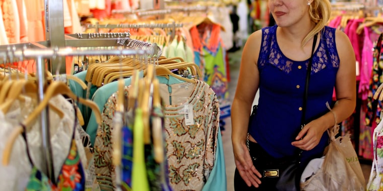 A shopper looks for clothes in a Miami store.