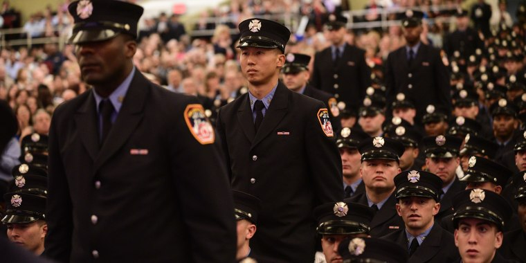 Danny Chan, 31, graduates from FDNY Fire Academy on Nov. 6 as one of seven Asian-American probationary firefighters.