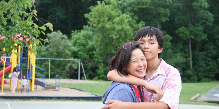 Frances Kai-Hwa Wang with her son at 5th grade graduation in Michigan, June 2015