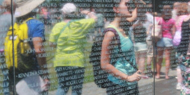 Jacqueline Mac, one of the project's narrators, observing the Vietnam Veterans Memorial in Washington, D.C.