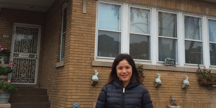 Yesenia Ariza, a 28-year-old Mexico native and recipient of the Deferred Action for Childhood Arrivals program, stands in front of the house she purchased in June 2014.