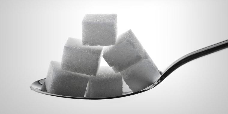 spoon with lump sugar