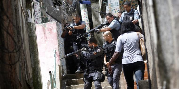 Image: Policemen patrol Rocinha in this 2012 file photo.