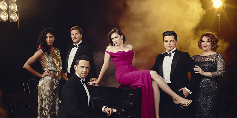 """The cast of """"Crazy Ex-Girlfriend."""" Pictured (L-R): Vella Lovell as Heather, Pete Gardner as Darryl, Santino Fontana as Greg, Rachel Bloom as Rebecca, Vincent Rodriguez III as Josh, and Donna Lynne Champlin as Paula."""