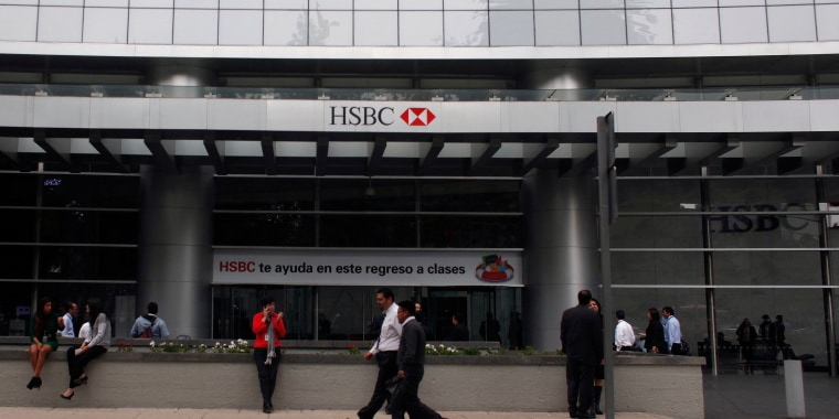 Image: Pedestrians walk past the entrance of British bank HSBC's headquarters in Mexico City