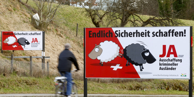 Image: Swiss People's Party posters are displayed beside a road in Adliswil, Switzerland