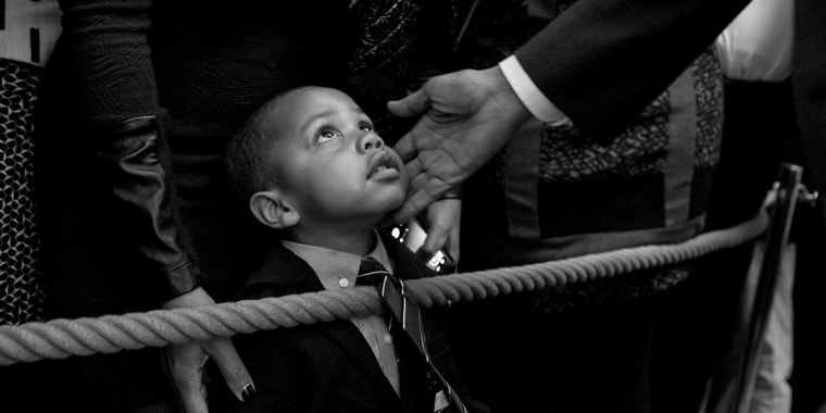 Image: President Barack Obama greets a young guest during a reception celebrating African American History Month