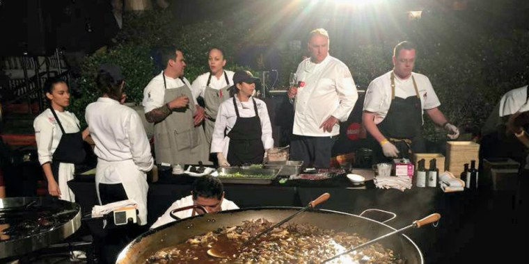 Acclaimed chef Jose Andrés makes a paella at the start of the South Beach Wine and Food Festival in Miami, on Thursday, Feb. 25, 2016.