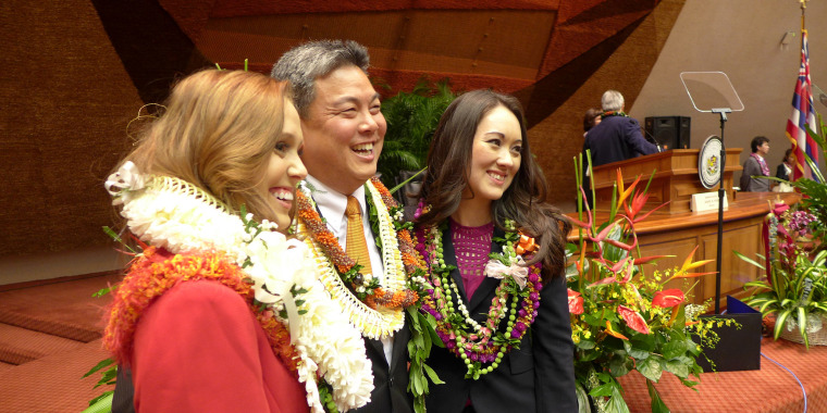 On the left, Hawaii state Rep. Beth Fukumoto Chang, a Republican, with Rep. Mark Takai, a Democrat, center.