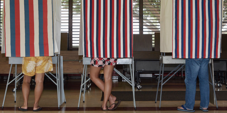 Image: Voters cast their ballots at Mililani Waena Elementary school Saturday, Sept. 23, 2006, in Mililani, Hawaii.