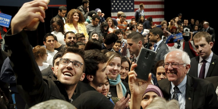 Image: U.S. Democratic presidential candidate Bernie Sanders greets supporters at a campaign rally in Dearborn