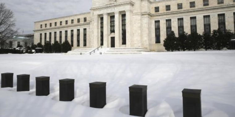 Snow covers the grounds of the U.S. Federal Reserve in Washington