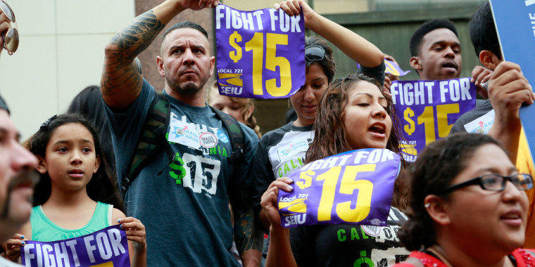 In this Tuesday, July 21, 2015 file photo, workers hold a rally in Los Angeles in support of the Los Angeles County Board of Supervisors' proposed minimum wage ordinance. On Saturday, March 26, California legislators and labor unions reached an agreement that will take the state's minimum wage from $10 to $15 an hour.