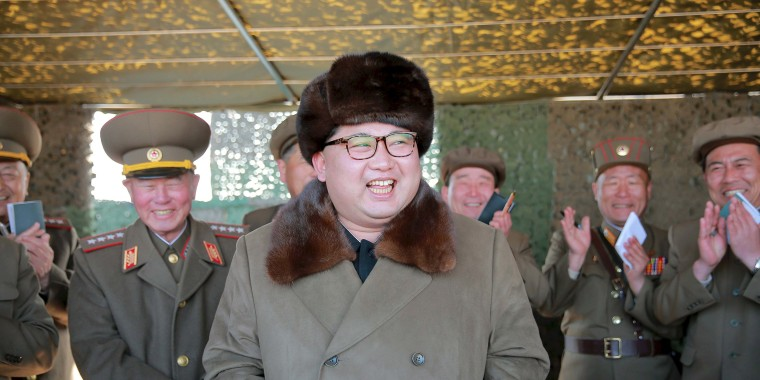 Image: File photo of North Korean leader Kim Jong Un attending a demonstration of a new large-caliber multiple rocket launching system at an unknown location