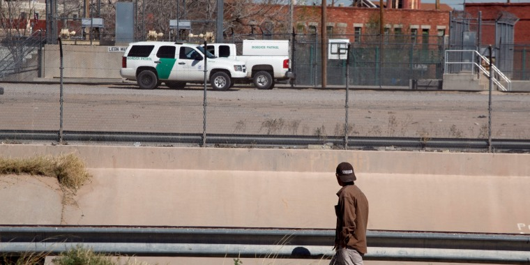 Image: A man looks at Border Patrol vehicles parked in El Paso, Texas, as seen from Ciudad Juarez