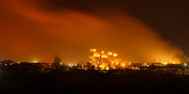 A plume of smoke rises over the State oil company Petroleos Mexicanos' petrochemical plant