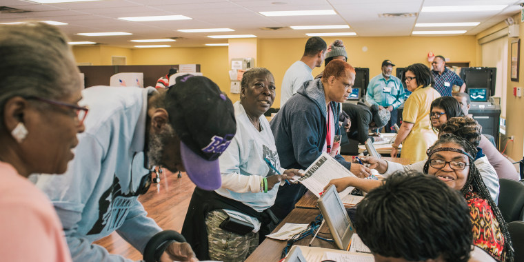 Image: Trina Ashley from Baltimore's Penn North neighborhood checking in to vote