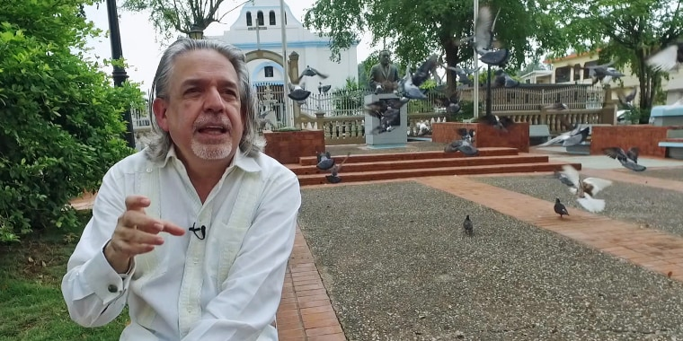 """Lin-Manuel Miranda's father, Luis Miranda, sits in the town square, or """"placita"""" in his hometown of Vega Alta, Puerto Rico. Like many, he is extremely worried about the island's spiraling economic crisis."""