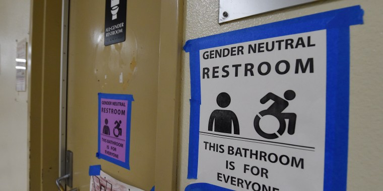 Signs are posted outside the Santee High School's gender neutral restrooms at their campus in Los Angeles, California on May 4, 2016.