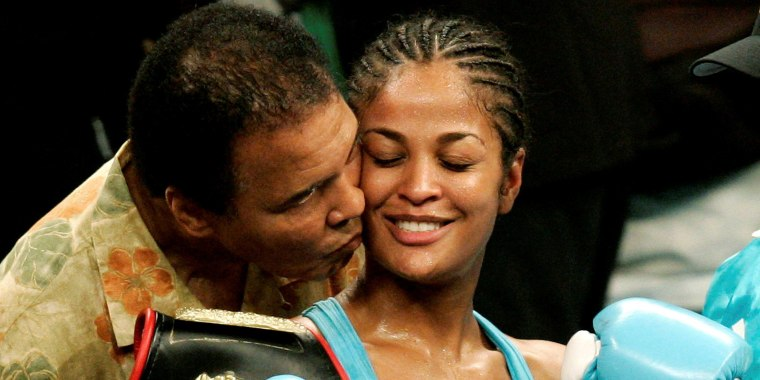 Image: Laila Ali is kissed by her father, boxing great Muhammad Ali