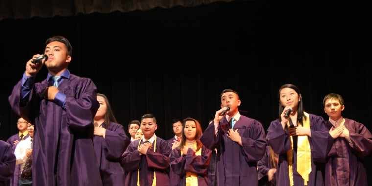 Students from the Hmong American Peace Academy singing during their graduation ceremony.