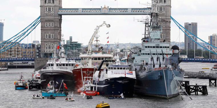 Image: Remain campaigners in dinghies try to disrupt a demonstration by a flotilla of fishing vessels campaigning to leave the European Union on the river Thames in London